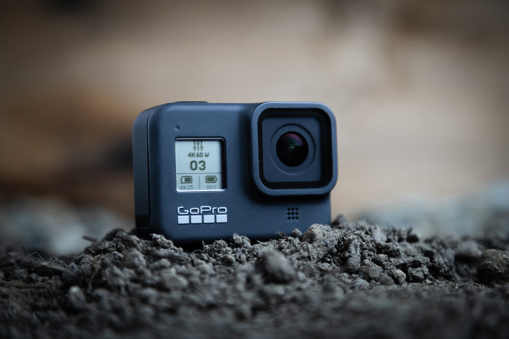 GoPro Hero 8 in the dirt showing the front screen.
